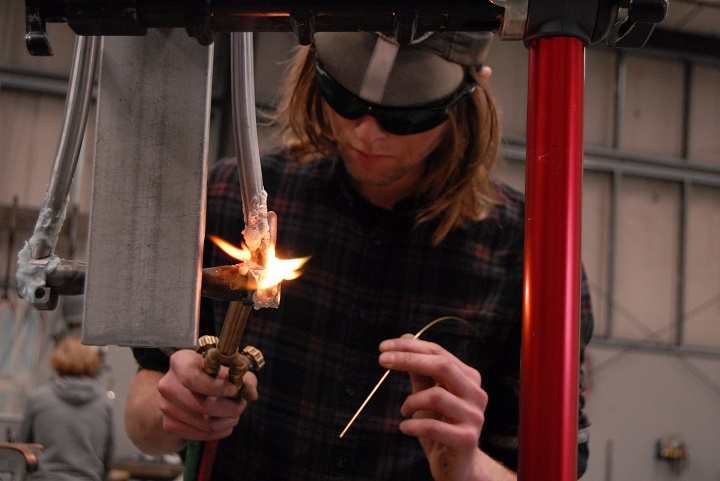 Reese brazing in his own dropouts on his own custom steel rando/road bike.