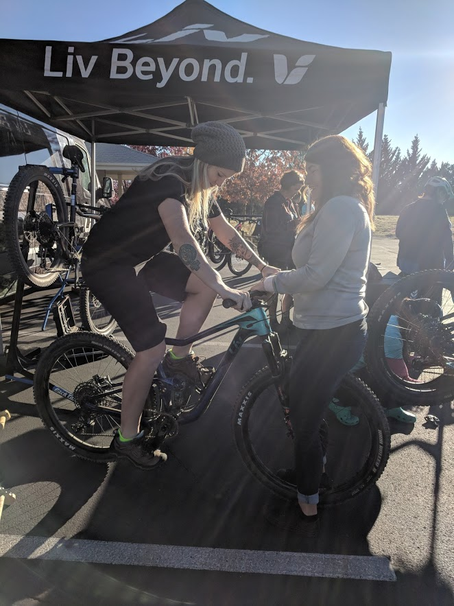 Kelsey and classmate/LIV cycling rep Acacia Wytaske sizing up a bike for the mountain bike ride.
