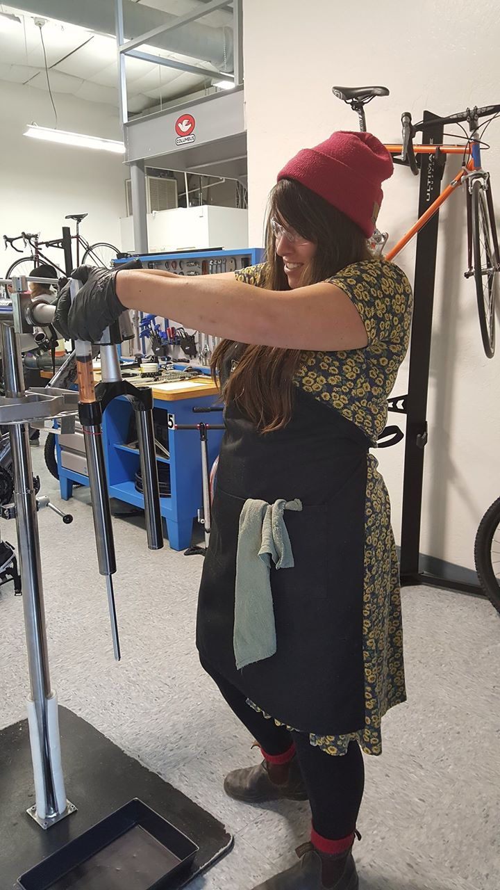 Hill adding oil to a suspension fork during a hands on.